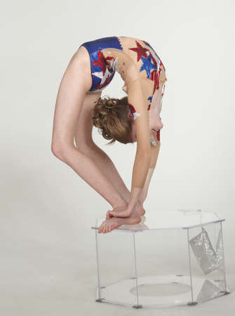 bent: Girl contortionist bent over backwards Stock Photo