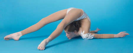 bent over: Girl contortionist bent over backwards Stock Photo