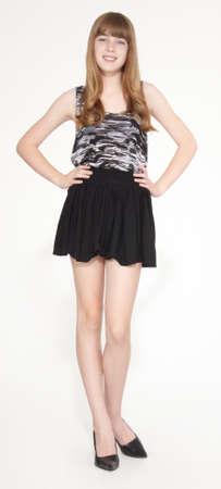 leggy girl: Teen Girl in Short Skirt and Heels Stock Photo
