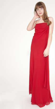 Blond teen girl in a long dress and heels Stock Photo