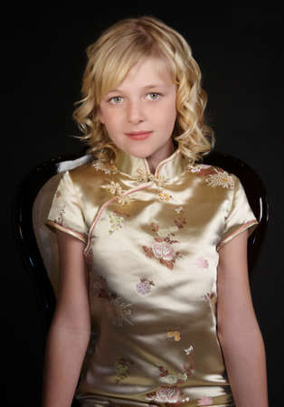 chinese dress: Blond Teen Curly Haired Girl in Gold Chinese Dress