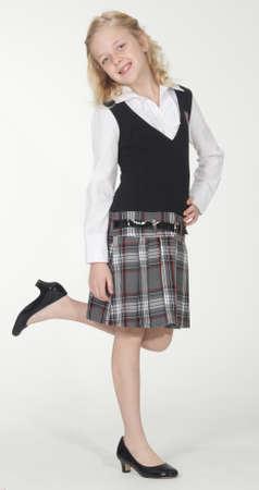 private schools: Private Catholic school girl against a white studio background