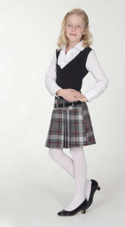 Catholic School Girl Posing in School Uniform photo