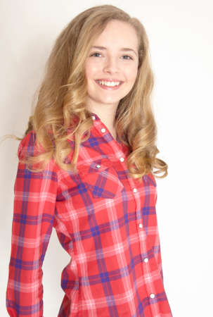 Portrait of a blond teen girl in a plaid shirt photo