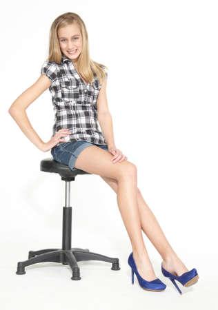 leggy: Teen Girl Sitting Jean Shorts and Heels