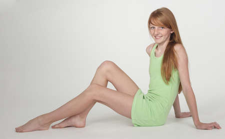redhead: Teen Girl in Short Green Pullover with bare legs
