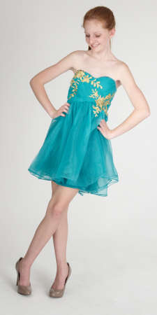 Red Head Teen Girl in a Blue Dress and Heels photo