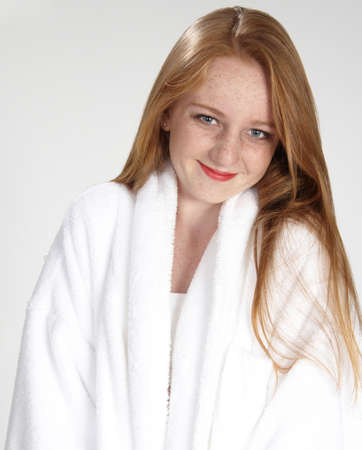 Head Shot of Teen Girl Red Head in a white robe