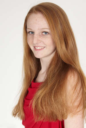 Head Shot of Teen Girl in a red dress with red hair Stock Photo