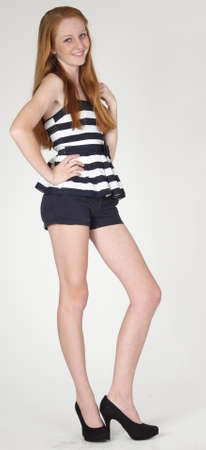 Red Head Teen Girl  in shorts and high heels photo