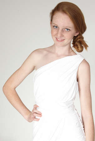 Head Shot of Teen Girl Red Head in a white toga