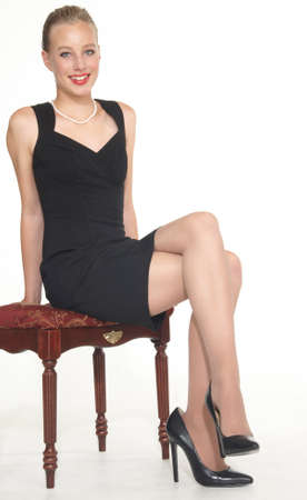 Elegant Teen Girl in Black Dress and Heels photo