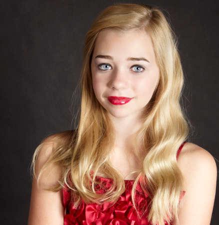 Portrait of Blond Girl in Red Top Black Background Reklamní fotografie