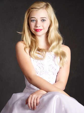 Blond Girl Portrait in Formal White Dress Reklamní fotografie