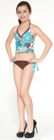 pre teen: Teen girl modeling a two piece swim suit Stock Photo