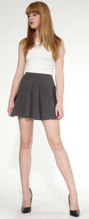 youth background: Pretty blond girl in short skirt and high heels