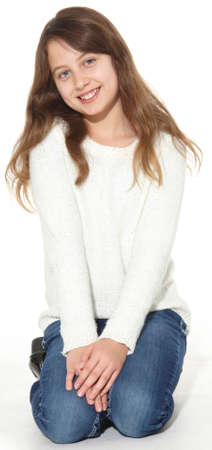 Attractive young girl posing in a white sweater