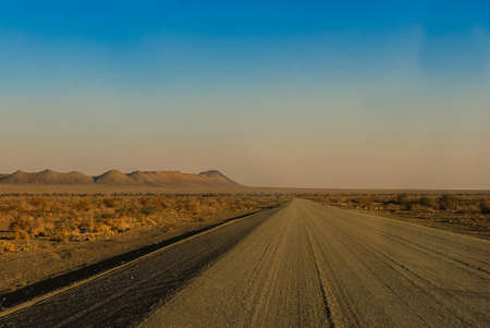 Gravel road near Ai-Ais Richtersveld Transfrontier Park, near Fish River Canyon, one of the largest canyons in the world in Namibia, Africa