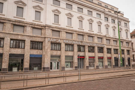Milan, Italy, April 2020, Banca Nazionale dell'agricoltura, (National Bank of Agricolture), Piazza Fontana, in downtown of the city closed, empty of people during covid19 Coronavirus epidemic