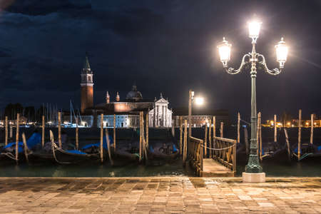 Chiesa di San Giorgio by night with acqua alta (high water) from San Marco Square in Venice, Venice