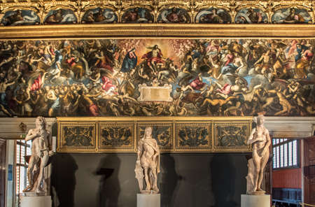 Venice, Italy - Oct 3, 2020: Interior of the Doge's Palace, the Sala dello Scrutinio. Fresco: Last Judgment of Jacopo Palma the Younger, 1595 - Statue: Mars, Adam and Eva of Antonio Rizzo, 1472