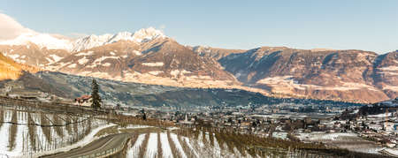 Beautiful view on the alpin city of Meran (Merano) and the Village of Lagundo (Algund) and Foresta (Forst) in Südtirol, Alto Adige, Italy under the snow in winter