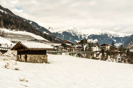 The small village San Martino in Passiria (St. Martin in Passeier in german) covered in snow, with alps mountains, South Tyrol, Alto Adige, Südtirol, Italy.