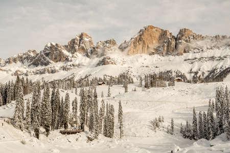 The Rosengarten-Schlern group (Gruppo Catinaccio Sciliar) and the village of Karersee or Carezza in the Dolomites in Italian Alps, Südtirol, Alto Adige in winter with snow Reklamní fotografie