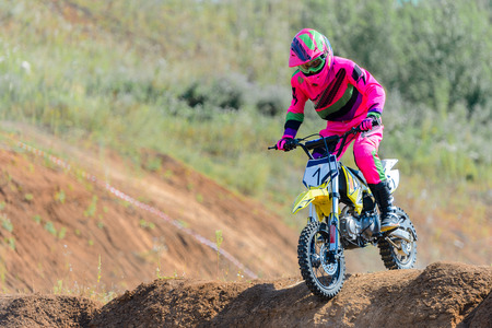 The young sportsman on a motorcycle jump