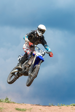 road bike: The young sportsman on a motorcycle jump