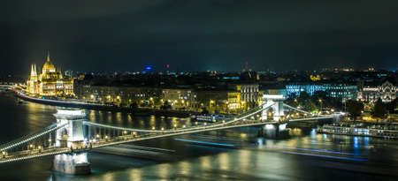 A night view of the Danube River and bridges in Budapest. Hungary