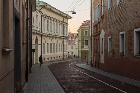 Narrow street in the Old Town of Vilnius at sunrise. Lithuania Stock Photo
