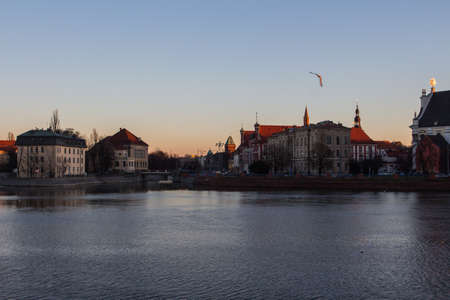 View of the river embankment in the city of Wroclaw at sunset. Poland