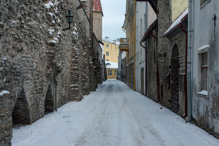 Narrow street in Old Town Tallinn in winter. Estonia
