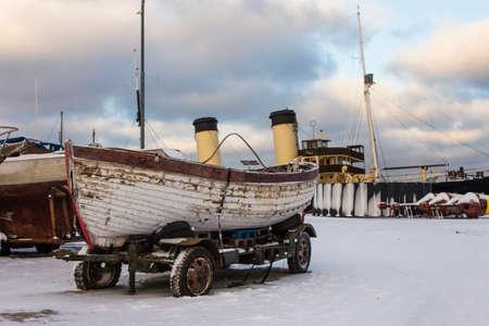 Historic wooden boat at the Flight Harbor Museum in Tallinn in winter. Estonia 版權商用圖片