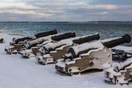 Historic guns on the pier at the Flight Harbor Museum in Tallinn in winter. Estonia