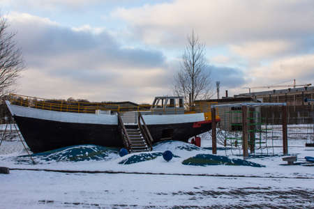 Playground in the form of a ship at the Maritime Museum Seaplane in Tallinn in winter. Estonia