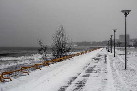 Embankment of the Baltic Sea in Tallinn during snowfall in winter. Estonia