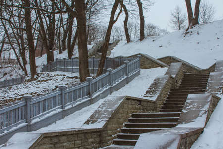 Snow covered steps in a park in Tallinn in snowfall. Estonia 版權商用圖片