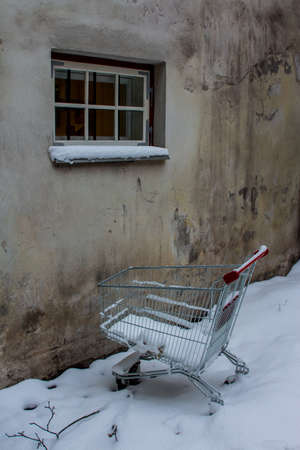 A supermarket basket is abandoned in a snowdrift in an alley in Tallinns Old Town. Estonia