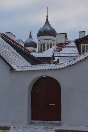 Historic gate on the Old Town street of Tallinn in winter. Estonia