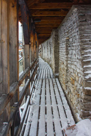 Wooden corridor on the defense medieval wall in Old Town Tallinn. Estonia