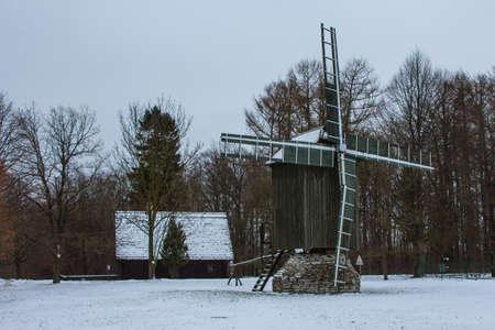 Historic wooden windmill at Tallinn Zoo in winter. Estonia