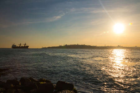 Silhouette of a tanker in the Bosphorus on the background of Istanbul at sunset. Turkey