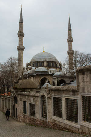 View of the Eyup Sultan Mosque in Istanbul in rainy weather, Turkey