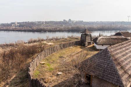 "Wooden buildings in the National Reserve ""Zaporizhzhia Sich"" on the island of Khortytsia in Zaporizhzhia. Ukraine Banco de Imagens"