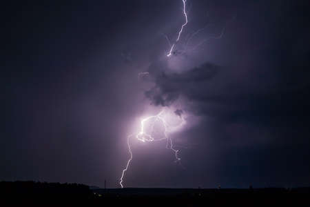 zapping: Dramatic big lightning striking down to the earth Stock Photo