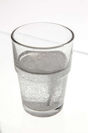 fizzy tablet: Fizzy tablet dropped in glass of water Stock Photo