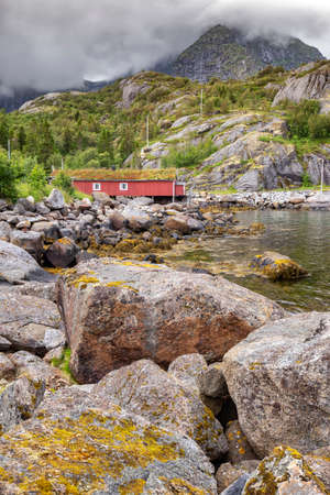 Red wooden house called rorbu at the Lofoten archipelago, North Norway Stock Photo