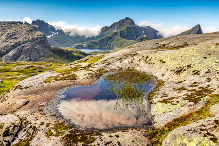 Heart-shaped puddle in the mountains in Lofotens, Norway Stok Fotoğraf